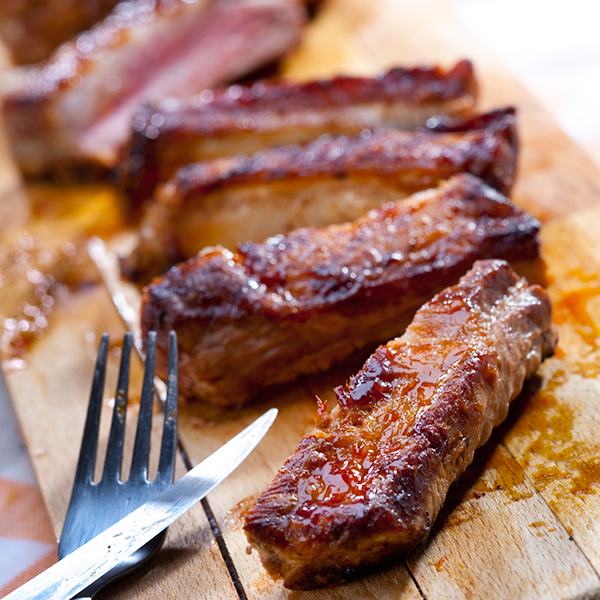 roasted spareribs on a cutting board