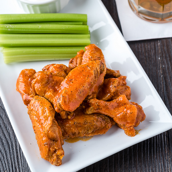 buffalo chicken wings on a square plate