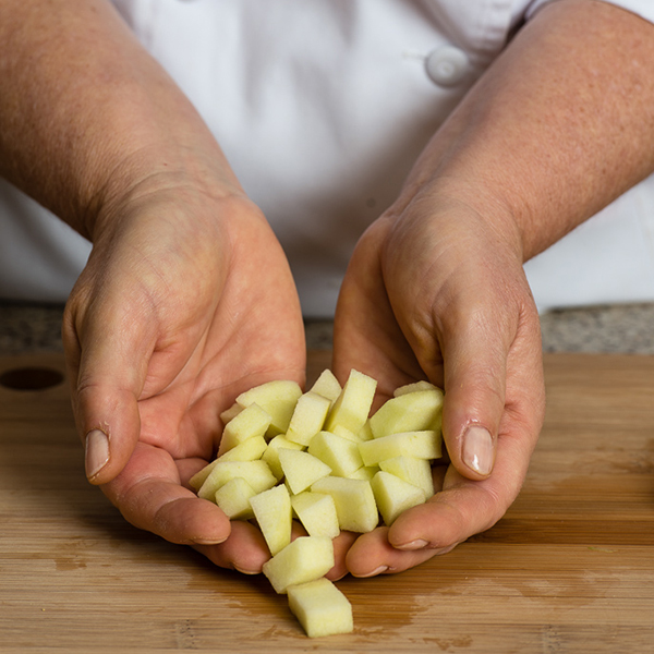 chopped apple in hands