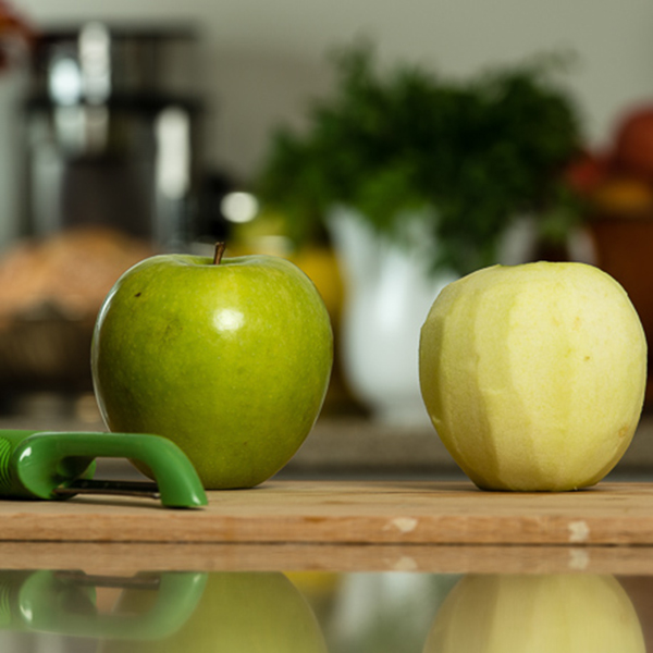 apple peeled on a cutting board