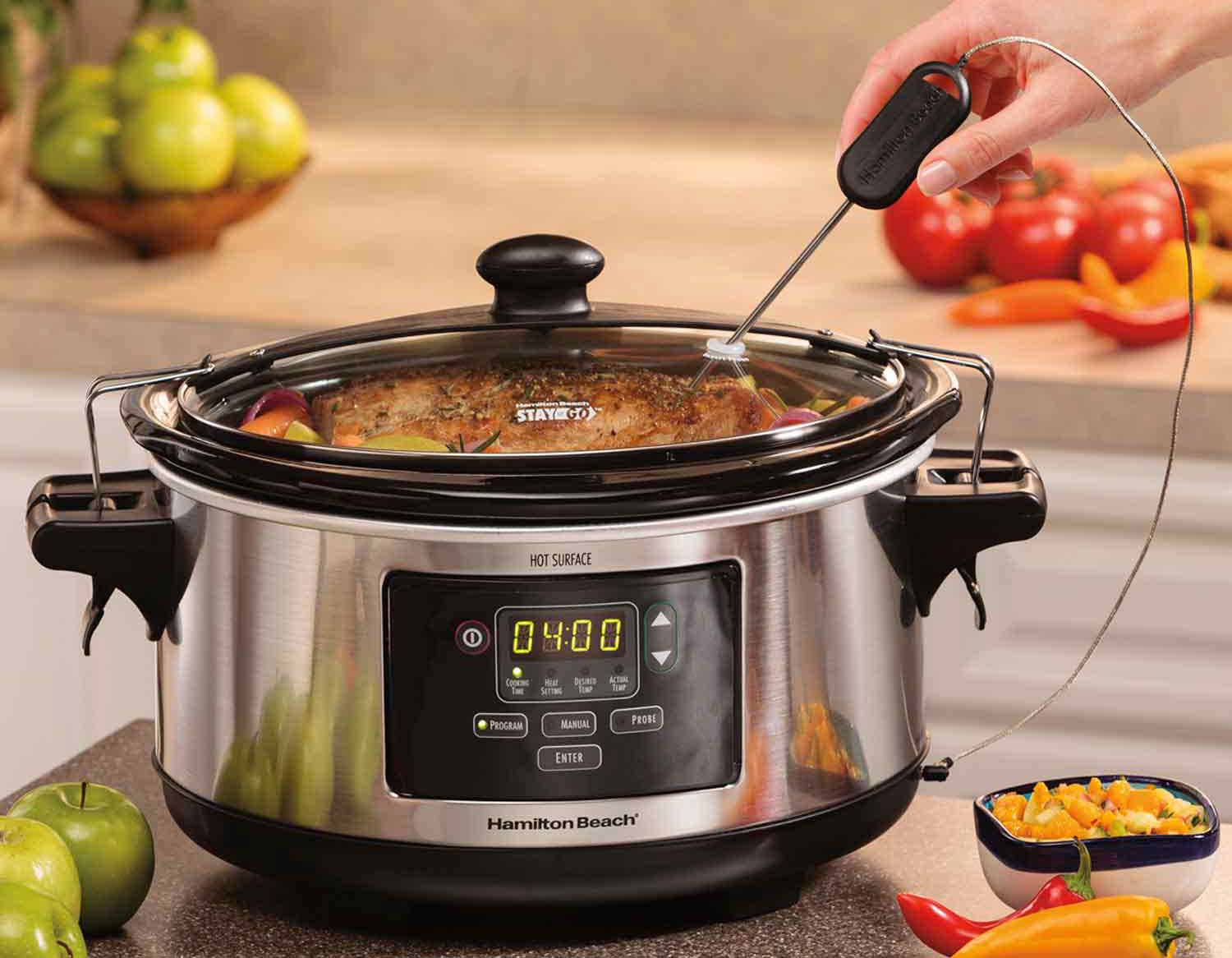slow cooker with temperature probe on a counter