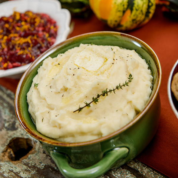 mashed potatoes in a bowl with rosemary