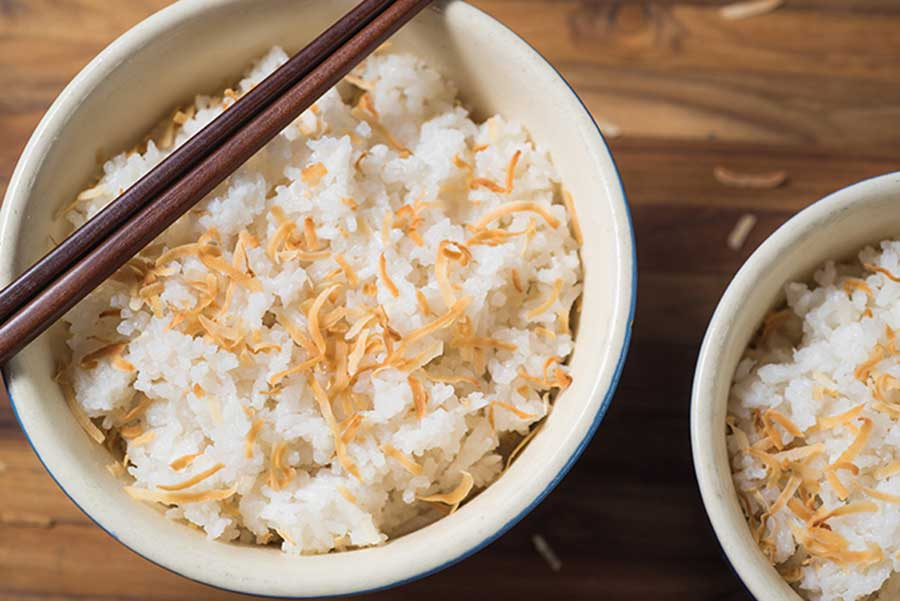 coconut rice in a white bowl on a table