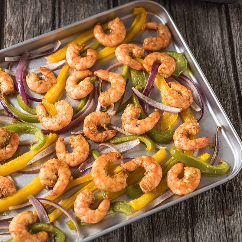 shrimp and peppers on a sheet pan