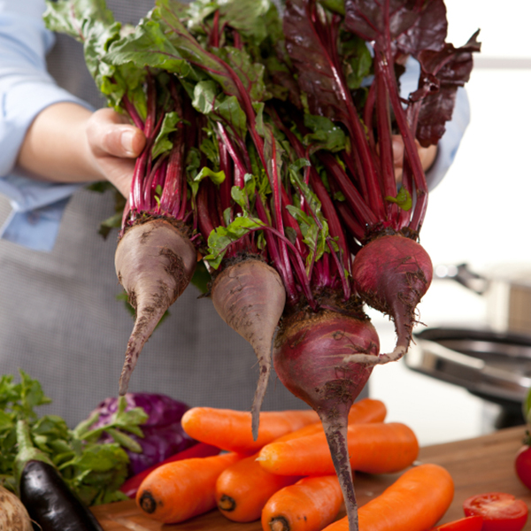 beets being held by a chef