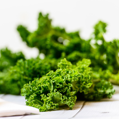 fresh kale on a white table