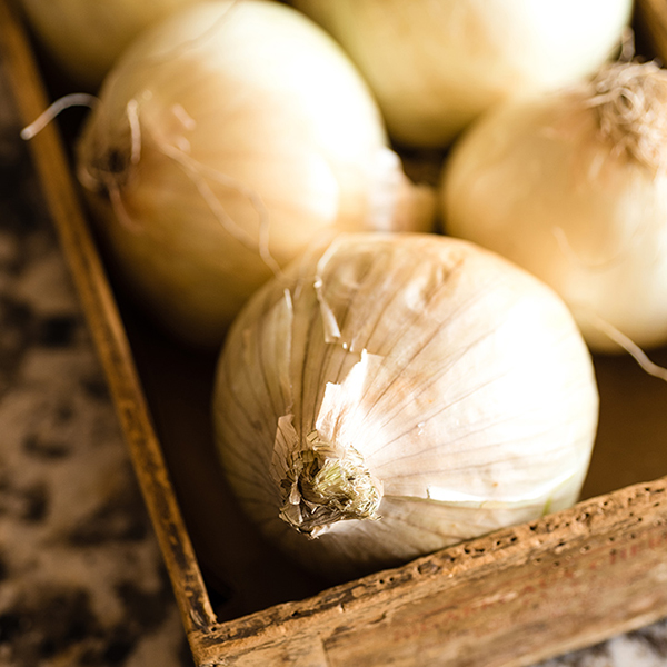 whole onions in a wooden box