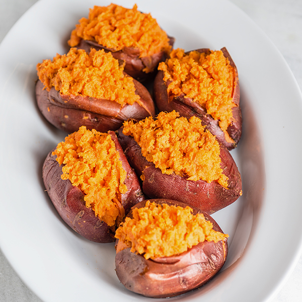 baked sweet potatoes in a white bowl