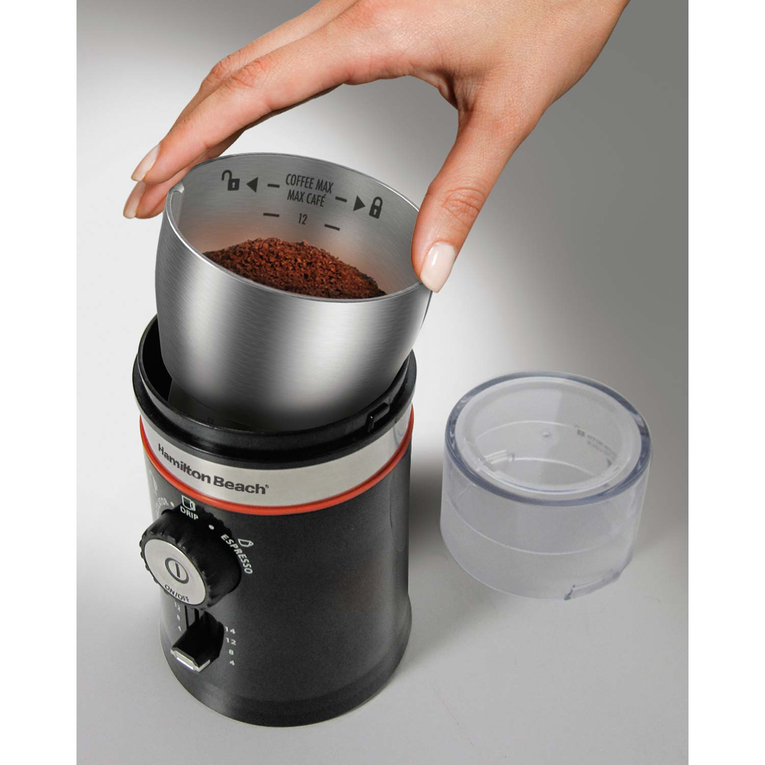 The Custom Grind Coffee Grinder features a removable stainless steel chamber for mess-free pouring and easy cleaning.