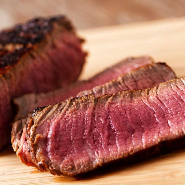 grilled steak cut in pieces