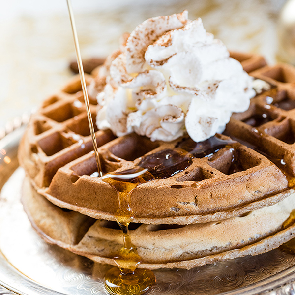 gingerbread waffles with whipped cream and syrup