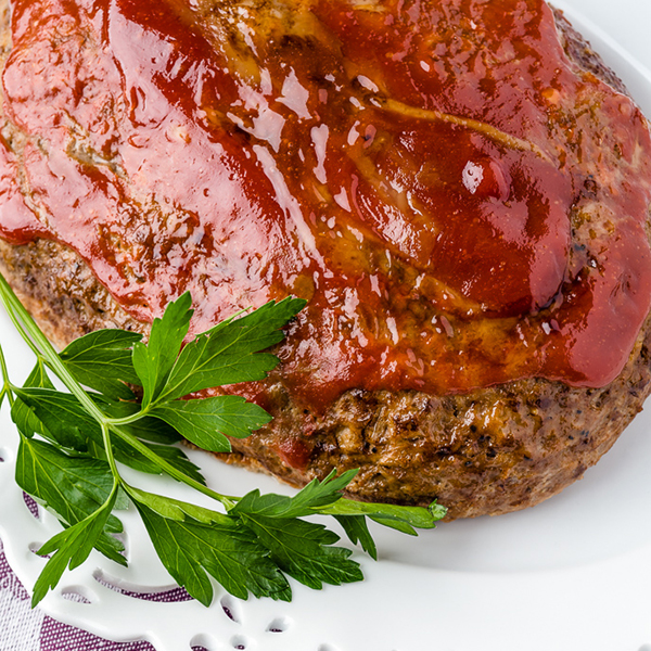 slow cooker meatloaf on a white plate