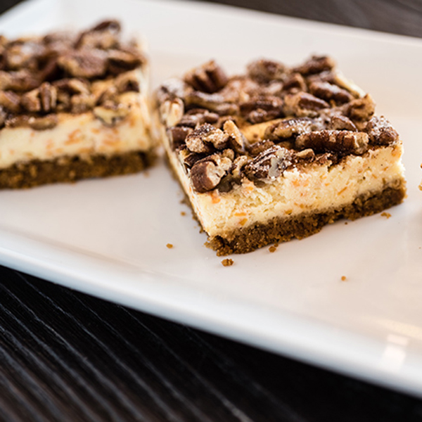 sweet potato cheesecake bar on a white plate