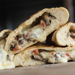 Quick & Easy Mushroom and Red Pepper Calzones image